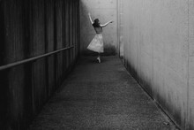 Ballet Dancer Poses In Urban Street