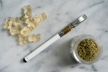 Gummi Bear Edibles, Electronic Cigarette, And Marijuana In Jar