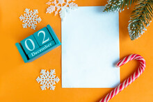 December 2. Blue Cube Calendar With Month And Date And White Mockup Blank, Top View.