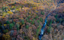 Aerial View Of River Flowing Through George Washington And Jefferson National Forests In Autumn