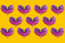 Pattern Of Pink And Purple Origami Hearts