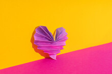 Studio Shot Of Pink And Purple Origami Heart