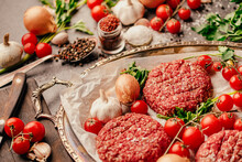 Round Ground Beef Portioned Beef Patties Made From Beef Mince Prepared For On A Platter.Hamburger Meat Seasoned And Ready For A Barbecue.Spices And Condiments For A Grill.Homemade Keto Burger Recipe.