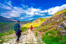 Toourist Hiking In Snowdon National Park In North Wales. UK