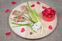Food Art Idea For Valentine Day, Birthday, Mother's Day. Flowers Made Of Meat On Wooden Cutting Board, Red Hearts And Natural Burlap Background.