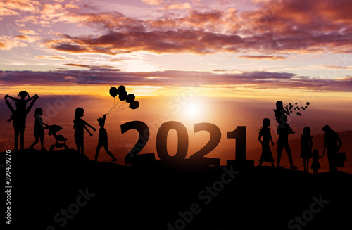 Silhouette of family on the top hills and sky sunset background, And 2021 happy фототапет