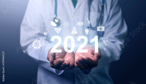 Fototapeta Medical Technology on 2021 target set goals achievement new year resolution, doctor health care worker planning saving world pandemic COVID-19 strategy ideas, graphic icon copy space blue background obraz