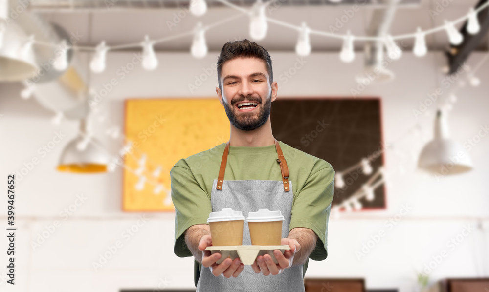 Fototapeta people, profession and job concept - happy smiling barman in apron holding takeaway coffee over restaurant background