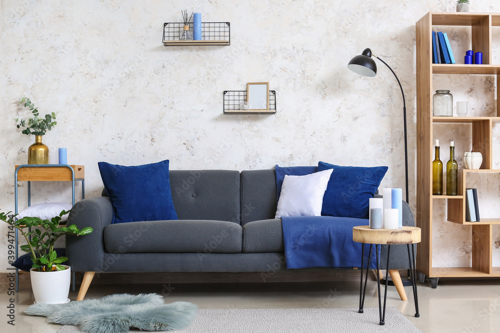 Fototapeta Stylish interior of living room with sofa and candles
