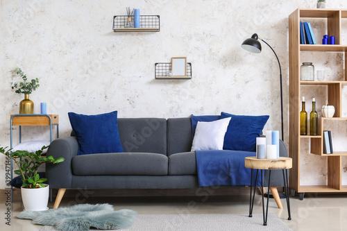 Fototapeta Stylish interior of living room with sofa and candles obraz