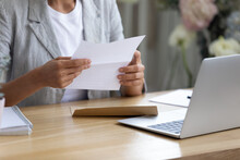 Getting News By Mail. Close Up Of Young Lady Involved In Paperwork At Home Office Studio Hold Paper Letter In Hands. Businesswoman Get Message Out Of Envelop Read Information From Bank Client Supplier