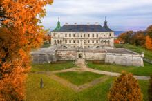 Podgortsy Palace From The Air. Sunset Over Autumn Park On Hills.