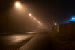 Fog in the streets of the town of Luckenwalde ,Road at night without people and cars
