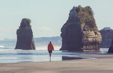 Tourist On New Zealand Beach