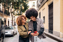 Afro Friends Using Phone