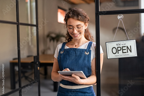 Small business owner using digital tablet at entrance Fototapet