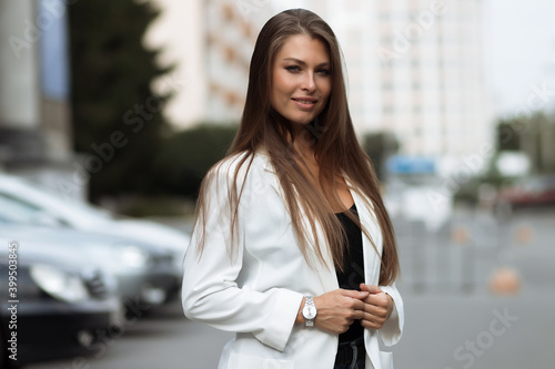 Fotografia, Obraz Young confident woman in stylish white outfit in park