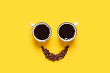Creative Composition With Cups And Coffee Beans On Color Background