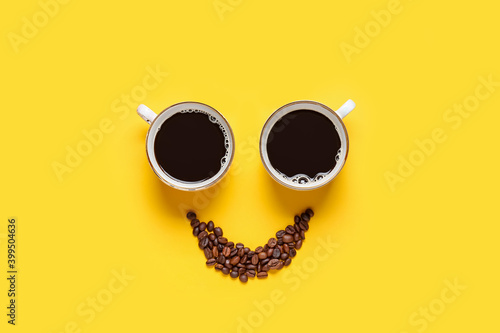 Leinwand Poster Creative composition with cups and coffee beans on color background
