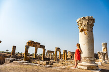 Tourist Young Girl In Hierapolis Ancient City Ruins Pamukkale Turkey. UNESCO World Heritage Site.