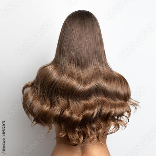 wavy blonde brown hair back view. Grey background