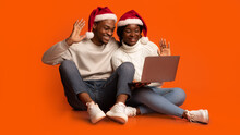 Young Black Spouses In Santa Hats Making Video Call On Laptop Computer