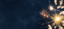 Silvester Background Banner Panorama Long- Firework And Sparklers On Rustic Dark Blue Night Sky Texture