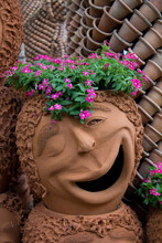 Clay Flowerpot With Human Face Shape And Cute Emotion,unique Art Planter Sculpture For Exterior Design,handmade Decorative Element For Gardening With Positive Mood On The Face,outside Vase With Flower