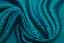 Close-up Texture Of Natural Tidewater Green Fabric Or Cloth In Green  Color. Fabric Texture Of Natural Cotton Or Linen Textile Material. Green Canvas Background.