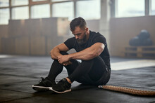 Man Resting After A Battle Rope Workout