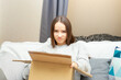 The frustrated woman opens the package box