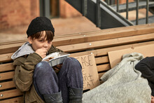 Abandoned Caucasian Kids In City Streets, Ask For Money And Help, Poor And Dirty Without Home