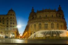 Impressive Architecture And Fountain Piazza De Ferrari At Dusk, Genoa, Italy.