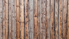 Abstract Background Of Textured Brown Wooden Wall.