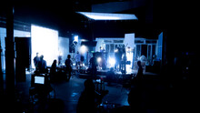 Silhouette Images Of Video Production Behind The Scenes Or B-roll Or Making Of TV Commercial Movies That Film Crew Team Lightman And Videos Cameraman Working Together With Movie Director In Studio.