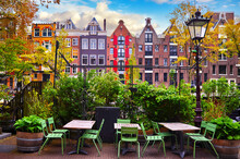 Amsterdam Netherlands. Traditional Brown House At Coast Channel Picturesque Landscape Panorama With Blue Sky And White Cloud.
