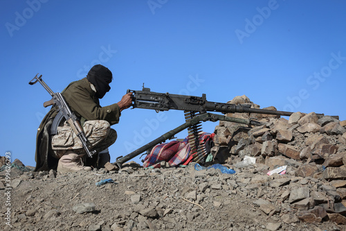 A Yemeni soldier fights in the ranks of the legitimate army against the Houthi m Wallpaper Mural