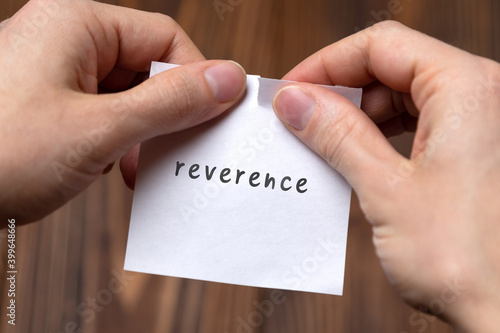 Hands tearing off paper with inscription reverence Fototapet