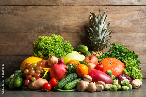 Assortment of fresh organic fruits and vegetables on grey table © New Africa