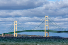 The Mighty Mackinac Bridge, One Of The World's Longest Suspension Bridges Spanning The Straits Of Mackinac, Connects The Upper And Lower Peninsulas Of Michigan In America's Upper Midwest.