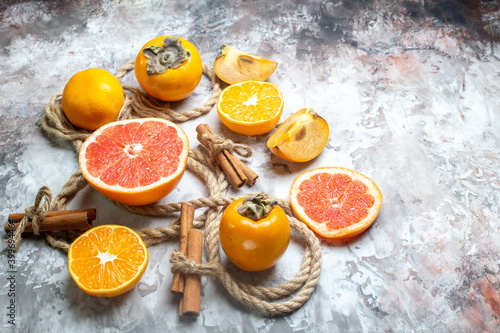 front view fresh persimmons with grapefruit on light background fruit ripe citrus color health fresh
