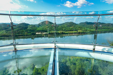 Phra Yai Phu Khok Ngio, Chiang Khan,Thailand - November 27,2020 : Close-up, Floor And Rail Of A Clear Sky Walk Overlooking The Treetops, The Mekong River And The Mountains Of Laos PDR.
