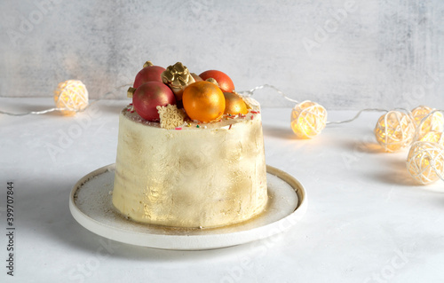 Fototapeta Christmas cake decorated with figures of Christmas balls. Color of the year 2021 obraz