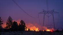 California Wildfire Burns Under Power Lines