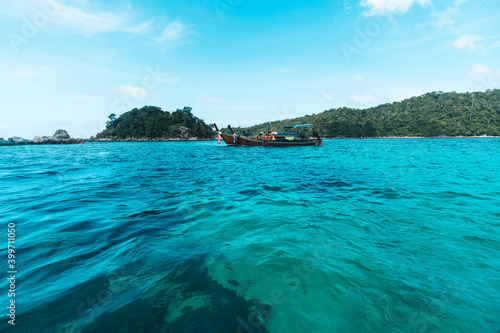 Long-tailed boat prow in the blue sea and clear sky. Wallpaper Mural