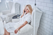 Happy Cheerful Woman Relaxing While IV Infusion In Beauty Salon