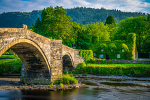 Stone Bridge And Old Cottage Covered With Vine Leaves, Llanrwst, Caernarfon, North Wales