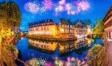 Fireworks At The Old Town Water Canal Panorama Of Strasbourg, Alsace, France. Traditional Half Timbered Houses Of Petite France