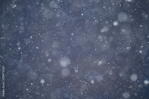 Stampa su Tela blurred background snowfall nature, abstract falling snowflakes design