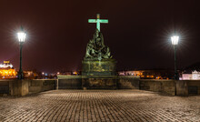 Prague, Czech Republic-January 31, 2019. Night Scene. Statue Of The Lamentation Of Christ On The South Side Of The Charles Bridge, Depicts Mary Magdalene And The Virgin Mary Mourning The Dead Christ.